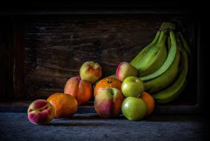 Фотография Бананы Яблоки Персики Мандарины Натюрморт
