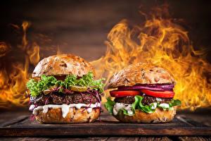Картинки Фастфуд Гамбургер Овощи Огонь Двое Еда