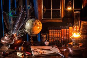 Фотография Керосиновая лампа Перья Книга Очки Глобус Дым