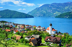 Картинки Швейцария Озеро Горы Здания Крыша Engelberg Lake Lucerne Города