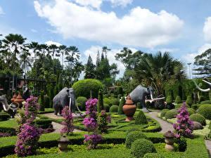 Фотография Таиланд Сады Скульптуры Мамонты Дизайн Кусты Пальмы Nong Nooch Tropical Botanical Garden Природа