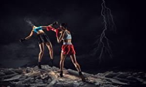 Фото Бокс 2 Ноги Рука Молнии Шорты Дерется Бьет молодые женщины Спорт