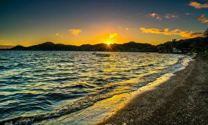 Картинка Берег Рассветы и закаты Волны Штаты Океан Гавайи Солнце Kaneohe Bay