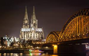 Картинка Кёльн Германия Здания Реки Мост Ночью Уличные фонари