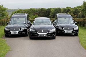 Картинка Jaguar Втроем Черный Металлик Спереди Jaguar XJ Автомобили