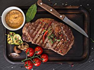 Фотографии Мясные продукты Томаты Ножик Разделочная доска