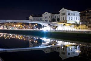 Фото Испания Здания Мосты Ночь Отражение Уличные фонари Водный канал Bilbao Basque Country
