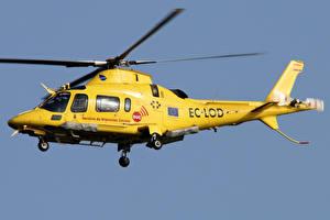 Фотографии Вертолеты Желтый Полет Agusta A.109E Power