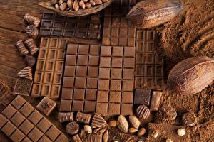 Картинка Сладости Шоколад Орехи Шоколадка Какао порошок