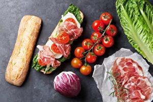 Фотография Бутерброды Ветчина Хлеб Томаты Еда