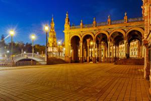Фотография Испания Дома Мосты Городская площадь Ночь Уличные фонари Seville Spanish Square Города