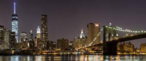 Картинка США Дома Реки Мосты Небоскребы Манхэттен Ночь Города