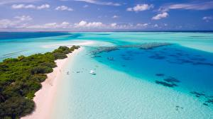 Фотографии Побережье Мальдивы Море Пляж Горизонт