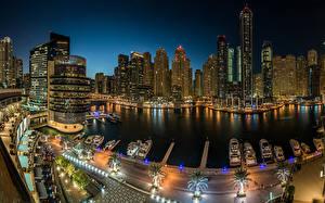 Фото Дубай Объединённые Арабские Эмираты Дома Небоскребы Причалы Яхта Ночь Города
