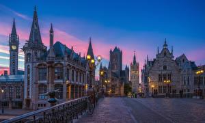 Фотографии Гент Бельгия Здания Вечер Улица Ограда Велосипед Уличные фонари
