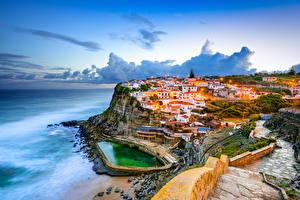 Фотография Португалия Берег Дома Вечер Утес Облака Azenhas do Mar Sintra