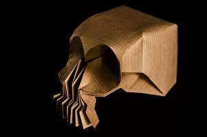 Фото Черепа Крупным планом Бумаги Оригами На черном фоне