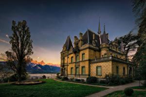 Фотографии Швейцария Замки Вечер Деревья Газон Hunegg Castle Hilterfingen Города