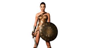 Фото Чудо-женщина (фильм) Чудо-женщина герой Галь Гадот Воин Белым фоном Щит С мечом Фильмы Девушки Знаменитости