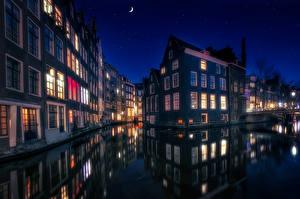 Фотографии Амстердам Нидерланды Здания Ночные Водный канал