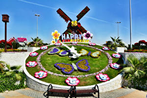 Картинка Дубай Сады Бабочки Часы Дизайн Мельница Miracle Garden Природа