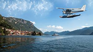 Фотография Италия Небо Самолеты Здания Горы Гидросамолёт Залив Varenna Природа