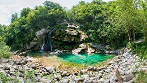 Фотография Словения Водопады Камень Утес Деревья Bovec Природа