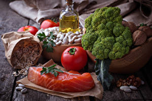 Фотография Натюрморт Рыба Помидоры Орехи Овощи Еда