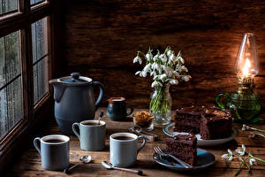 Фото Натюрморт Галантус Керосиновая лампа Кофе Торты Кувшин Чашка Ложка Пища