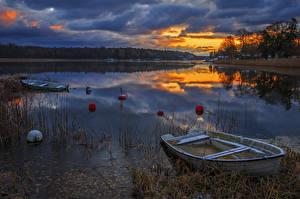 Фото Швеция Рассветы и закаты Реки Лодки Вечер Природа