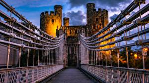 Картинка Великобритания Замки Мост Вечер Забор Уэльс Deganwy Castle город