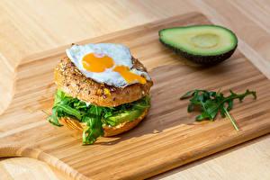 Фотография Бутерброды Манго Разделочная доска Яичница
