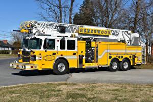 Фотографии Пожарный автомобиль Желтый Spartan Gladiator Smeal Sirius 105 Ladder