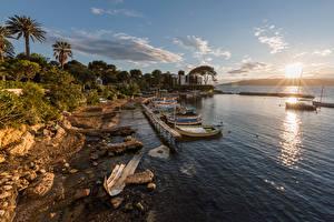 Фотографии Франция Побережье Причалы Лодки Рассвет и закат Камни Antibes Provence Природа