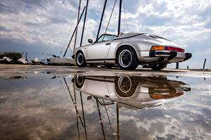 Фотографии Porsche Отражении Кабриолет Лужа 911 Carrera авто