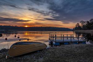 Обои Швеция Рассветы и закаты Речка Побережье Лодки Пирсы