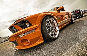 Картинки Крупным планом Форд Колесо Оранжевые Металлик Mustang, Cobra авто