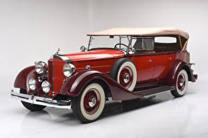 Фотографии Ретро Цветной фон Красный Металлик 1934 Packard Eight 7-passenger Touring Авто