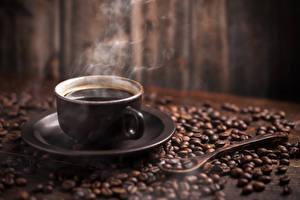Картинки Кофе Чашка Зерна Пар Блюдце Продукты питания