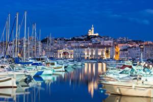 Фотографии Франция Марсель Здания Пирсы Яхта Парусные Катера Ночные Города