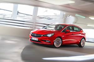 Фотографии Opel Красный Едущий Astra 2015
