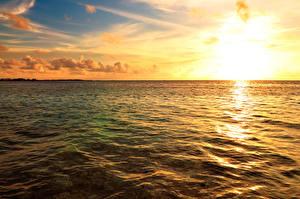 Фотографии Португалия Море Рассвет и закат Небо Горизонта Maldives Природа