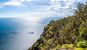 Фотографии Португалия Небо Океан Скала Облака Madeira Природа