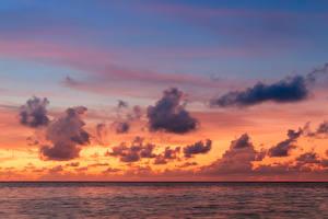 Фото Мальдивы Море Небо Рассветы и закаты Облака