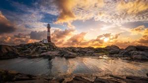 Фотография Норвегия Маяки Рассветы и закаты Небо Берег Камень Облака Nymark Rogaland