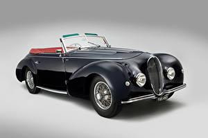 Фотографии Винтаж Черный Кабриолет Серый фон 1946 Delahaye 135 Cabriolet par Graber Автомобили