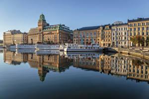 Картинки Швеция Стокгольм Здания Пирсы Речка Речные суда