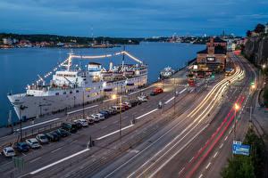 Фото Швеция Стокгольм Пирсы Корабли Дороги Вечер Здания Уличные фонари