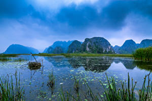 Фотографии Вьетнам Озеро Горы Небо Природа