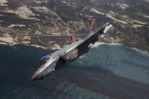 Фотографии Истребители Бомбардировщик Летящий Американские Lightning II, F-35 Авиация